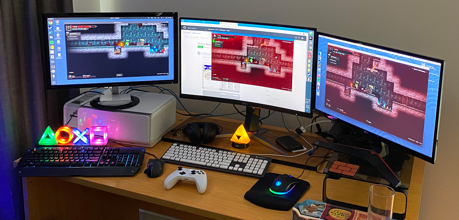 My desk. Testing Tallowmere 2's online co-op.